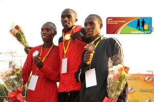 Philip Kipyeko (Silver) Joshua Cheptegei (gold) and Abdallah Mande (bronze pause after being crowned at the National cross country championships at Kololo Independence Grounds January 14, 2016. By Norman Katende